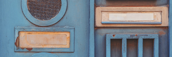 Letterboxes on a blue door