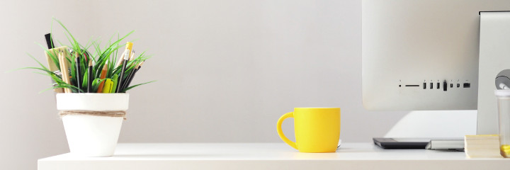 Yellow cup on desk
