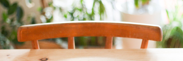 Wooden chair tucked under wooden table